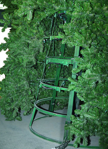 ... And Then The Large Branches Are Inserted Into The Frames. A Lower  Quality Version Of The Commercial Artificial Christmas Tree Consists Of ...